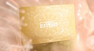 GIVE GLAMOUR-<br>M·A·C GIFT CARDS